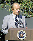 United States President Gerald R. Ford holds a press conference in the Rose Garden at the White House in Washington, D.C. on October 9, 1974.  The President said he did not think the country was in a depression and that inflation would be reduced in 1975.  He also said his proposed 5% tax would not extend beyond 1975.  Ford is wearing a red button with the letters &quot;WIN&quot; on his lapel.  &quot;WIN&quot; stands for &quot;Whip Inflation Now&quot;.<br /> Credit: Barry Soorenko - CNP