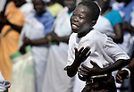 A boy, part of a liturgical dance group, dances during an outdoor Mass in Christ the King Catholic parish in Malakal, Southern Sudan, on November 21, 2010. NOTE: In July 2011 Southern Sudan became the independent country of South Sudan.