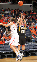 Dec. 18, 2010; Charlottesville, VA, USA; UMBC Retrievers guard Michelle Kurowski (20) shoots the ball in front of Virginia Cavaliers forward Chelsea Shine (50) during the game at the John Paul Jones Arena.  Mandatory Credit: Andrew Shurtleff