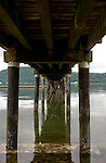 Pier stanchions supports reflected in the water, Close to Deep Cove,North Vancouver, British Columbia,Canada.