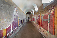 Cryptoporticus, vaulted corridor used for storing wine, with frescoes with trompe l'oeil detailing of pillars and garlands, and scenes from the Trojan War in the upper frieze, in the Casa del Criptoportico, or House of the Cryptoporticus, Pompeii, Italy. The house is one of the largest in Pompeii and was owned by the Valerii Rufi family and built in the 3rd century BC. It takes its name from the underground corridor or cryptoporticus used as a wine cellar and lit by small windows. Pompeii is a Roman town which was destroyed and buried under 4-6 m of volcanic ash in the eruption of Mount Vesuvius in 79 AD. Buildings and artefacts were preserved in the ash and have been excavated and restored. Pompeii is listed as a UNESCO World Heritage Site. Picture by Manuel Cohen