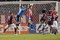 Colorado Rapids keeper Matt Pickens (18) punches the ball away from CD Chivas USA defender Jimmy Conrad (12) on his way to a clean sheet. The Colorado Rapids defeated CD Chivas USA 1-0 at Home Depot Center stadium in Carson, California on Saturday March 26, 2011...