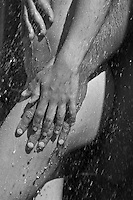 detail of a man and woman in an outdoor shower
