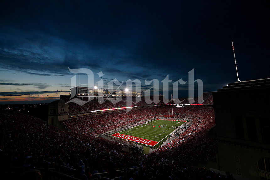 The sun sets during the second quarter of the NCAA football game at Ohio Stadium on Thursday, September 2, 2010. Ohio State Buckeyes vs. Marshall University Thundering Herd. Photo shot from the south stands. (Photo by Karl Kuntz)