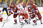 Marshall Everson (Harvard - 21), Ross Gaudet (BU - 22), David Valek (Harvard - 22) (Noonan) - The Harvard University Crimson defeated the Boston University Terriers 5-4 in the 2011 Beanpot consolation game on Monday, February 14, 2011, at TD Garden in Boston, Massachusetts.