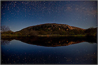 This photo taken in the Texas Hill Country shows the Milky Way over Moss Lake and Enchanted Rock in the wee hours of the morning.