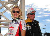Apr. 4, 2011; Las Vegas, NV, USA: NHRA funny car driver Courtney Force (left) with father John Force during testing at The Strip in Las Vegas. Mandatory Credit: Mark J. Rebilas-