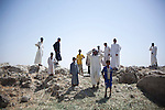 AL-SELKHA, IRAQ: A group of men and boys stand on the bank of a river near the village of Al Selkha...Dozens of families displaced by years of violence live in the village of Al Selkha in Nasiriya...Photo by Ali Arkady/Metrography