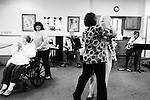 CHAD PILSTER &bull;&nbsp;Hays Daily News<br /> <br /> Darlene Herrick, left, resident, is pushed by Ruan Windholz, Wes Windholz&rsquo;s wife, and Treva Benoit, the director, and Bea Seba, a resident, all dance while Wes Windholz, on the accordion, and Rosie Dinkel, on saxophone, play polka music on Thursday, October 17, 2013 by the Wes Windholz Band at the Cedar View Assisted Living Residence in Hays, Kansas. The Wes Windholz Band plays the third Thursday of every month at area retirement homes.