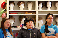 NWA Democrat-Gazette/DAVID GOTTSCHALK  Georgia Lashley (from left), Jack Hernandez and Martha Smith-Gomez, all seventh grade students at Gentry Middle School, listen to Jaclyn Keeter, director of Development and Outreach Services at Washington Regional Medical Foundation, inside the boutique at the Friday, February 24, 2017, at the Washington Regional Cancer Support Home, in Fayetteville. Students in the gifted and talented Quest class at Gentry Middle School wrote, illustrated and published the children's books to help inform and comfort children that visit or stay at the home.