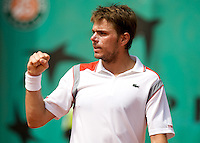 Stanislas Wawrinka (SUI) (17) against Nicolas Devilder (FRA) in the first round of the Women's Singles. Wawrinka beat Devilder 6-3 5-7 2-6 6-4 6-4 ..Tennis - French Open - Day 2 - Mon 25th May 2009 - Roland Garros - Paris - France.Frey Images, Barry House, 20-22 Worple Road, London, SW19 4DH.Tel - +44 20 8947 0100.Cell - +44 7843 383 012