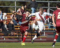 Virginia Tech defender Bradley Vorv (8) controls the ball as Boston College defender Matt Wendelken (8) defends.Boston College (maroon) defeated Virginia Tech (Virginia Polytechnic Institute and State University) (white), 3-1, at Newton Campus Field, on November 3, 2013.