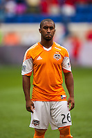 Corey Ashe (26) of the Houston Dynamo. The New York Red Bulls defeated the Houston Dynamo 2-0 during a Major League Soccer (MLS) match at Red Bull Arena in Harrison, NJ, on June 30, 2013.