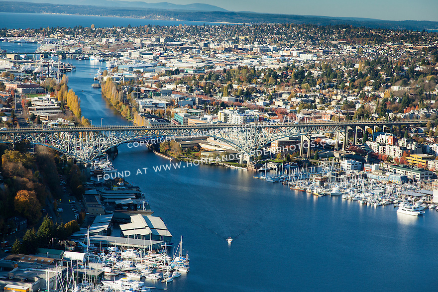 Aerial view of Seattle's Lake Union marinas and the Fremont Cut of the Lake Washington ship canal heading towards the Ballard Locks and Puget Sound