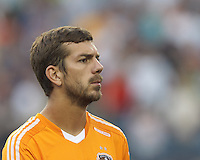 Houston Dynamo defender Eric Brunner (2). In a Major League Soccer (MLS) match, Houston Dynamo (orange) defeated the New England Revolution (blue), 2-1, at Gillette Stadium on July 13, 2013.