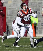 Nov 27, 2010; Charlottesville, VA, USA; Virginia Tech Hokies kicker Justin Myer (48) during the game at Lane Stadium. Virginia Tech won 37-7. Mandatory Credit: Andrew Shurtleff-