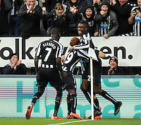 Jack Colback (centre) of Newcastle United celebrates scoring their first goal with team mates