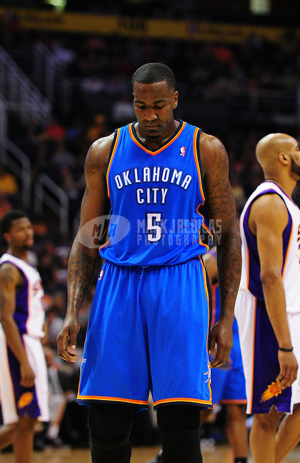 Mar. 30, 2011; Phoenix, AZ, USA; Oklahoma City Thunder center (5) Kendrick Perkins against the Phoenix Suns at the US Airways Center. Mandatory Credit: Mark J. Rebilas-