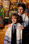 Bar Mitzvah boy and his older brother with the Torahs at CSI Synagogue, Briarcliff Manor, New York.