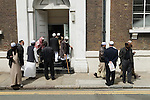 Men leaving Friday Prayers Jamme Masjid Mosque Brick Lane London E1.