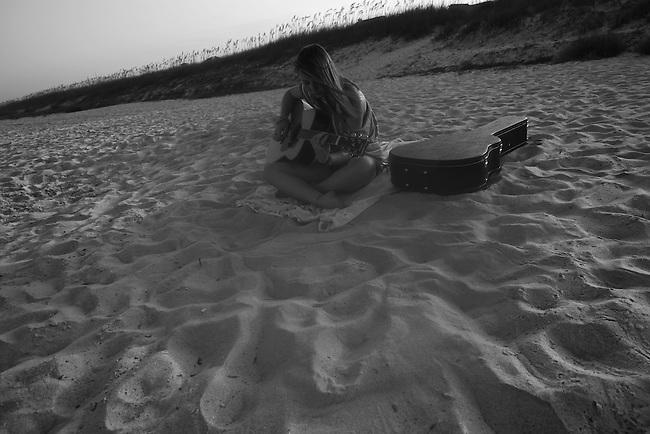 Elizabeth strums her guitar in Fernandina Beach, Fla. July 23, 2010.