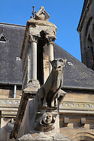 Gargoyle and butress of the Collegiale Notre-Dame de Poissy, showing the Western bell tower and chapels of the North aisle, a catholic parish church founded c. 1016 by Robert the Pious and rebuilt 1130-60 in late Romanesque and early Gothic styles, in Poissy, Yvelines, France. Saint Louis was baptised here in 1214. The Collegiate Church of Our Lady of Poissy was listed as a Historic Monument in 1840 and has been restored by Eugene Viollet-le-Duc. Picture by Manuel Cohen