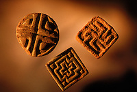 Harappan geometric button seals.  These are similar to pre-Harappan styles and also post Harappan styles and may reflect a distinct ethnic minority or religious symbols. Date to around 2200-1900 BC4,800 years ago, at the same time as the early civilizations of Mesopotamia and Egypt, great cities arose along the flood plains of the Indus and Saraswati (Ghaggar-Hakra) rivers.  Developments at Harappa have pushed the dates back 200 years for this civilization, proving once and for all, that this civilization was not just an offshoot of Mesopotamia..They were a highly organized and very successful civilization.  They built some of the world's first planned cities, created one of the world's first written languages and thrived in an area twice as large as Egypt or Mesopotamia for 900 years (1500 settlements spread over 280,000 square miles on the subcontinent)..There are three major communities--Harappa, Mohenjo Daro, and Dholavira. The town of Harappa flourished during this period because of it's location at the convergence of several trade routes that spanned a 1040 KM swath from the northern mountains to the coast.