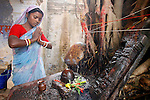 Photo by Heathcliff Omalley..Bihar State, India..Locals from the town of Mokama, in Bihar , India's most lawless state, celebrate a partial solar eclipse by taking a holy dip, Puja, before paying their respects at the local Shrine to the god Shiva.