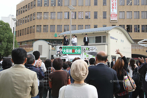 "November 2, 2011, Osaka, Japan - Toru Hashimoto, former Osaka Prefecture governor, addresses a crowd at the Suita railroad station square in Osaka, western Japan, on Wednesday, November 2, 2011. Hashimoto, the leader of the political group ""One Osaka (Osaka Ishin no Kai),"" resigned his post last month to run in the Osaka city mayoral race. Osaka will hold unprecedented mayoral and gubernatorial double elections on November 27 that will likely determine the future of the country's second-biggest city. (Photo by Akihiro Sugimoto/AFLO) [1080] -ty-"