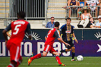 Michael Farfan (21) of the Philadelphia Union looks to cross the ball. The Philadelphia Union defeated Toronto FC 3-0 during a Major League Soccer (MLS) match at PPL Park in Chester, PA, on July 8, 2012.