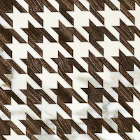 Houndstooth, a waterjet stone mosaic, shown in polished Calacatta and Bayard.