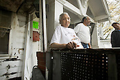 Zelia Stanback stands on the front porch of home she had been renting for 18 years on Queen St., in the Cleveland-Holloway neighborhood in Durham. Stanback complained about housing conditions to ACORN organizors, then a city housing inspector condemed the house.
