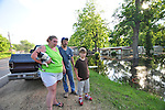 "8/13/11} Vicksburg} -- Vicksburg, MS, U.S.A. --Robert Shiers aka Peanut paddles past his hand built cabin in the woods too check on the flood waters Friday May 13,2011 Peanuts flooded cabin on Chickasaw Road was a cabin in the woods is now a cabin on the flooded Mississippi River.  Hope and faith float as the Mississippi River continues to rise around the Kings Community on Friday the 13th of May 2011. ""Peanut "" aka Robert Shiers navigates his ""John Boat"" down Chickasaw Rd. in Vicksburg Mississippi. His hand built ,self designed cabin which sits on 14ft. stilts on the old Belle Meade Plantation was on a 5acre wheat field that is now inundated with water and only able to get to by boat.  No mail today for residents of the Kings Community in Vicksburg MS Friday May 13, 2011.The Mississippi River in Vicksburg, Mississippi is expected to crest at a record 58.5 feet. The water is moving at 2.2million cubic feet per second, to put it in perspective it would fill the SuperDome in New Orleans in 30 seconds. Pictured is the historic Yazoo Valley Railroad Station in downtown Vicksburg. The River is flooding over 1.2 million acres of farm land and damaging thousands of homes and disrupting thousands of peoples lives. Vicksburg a riverfront town steeped in war and sacrifice, gets set to battle an age-old companion: the Mississippi River. The city that fell to Ulysses S. Grant and the Union Army after a painful siege in 1863 is marshaling a modern flood-control arsenal to keep the swollen Mississippi from overwhelming its defenses. PHOTO©SUZI ALTMAN.COM.Photo by Suzi Altman."