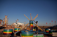 A carnival worker works on a ride in Columbus, New Mexico. Recently federal authorities arrested the mayor, police chief, and trustees who were allegedly operating an illegal gun running ring.