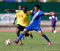 Andre Lewis (11) of Jamaica fights for the ball with Kevin Merida (17) of Guatemala during the group stage of the CONCACAF Men's Under 17 Championship at Catherine Hall Stadium in Montego Bay, Jamaica. Jamaica defeated Guatemala, 1-0.