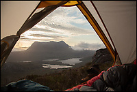 BNPS.co.uk (01202 558833)<br /> Pic: WildGuideScotland/BNPS<br /> <br /> Spectacular camping at Stac Pollaidh in Assynt.<br /> <br /> Scotland's stunning unspoiled scenery is being shown in a whole new light in a book that reveals the hidden gems off the beaten track north of the border.<br /> <br /> Three young photographers travelled the width and breadth of Scotland and snapped 750 picturesque places which include shimmering lochs, ancient forests, lost ruins, hidden beaches, secret islands, dramatic cliffs, tiny glens and mysterious grottoes. <br /> <br /> Friends Kimberley Grant, David Cooper and Richard Gaston, all in their late 20s, have spent the past two years exploring lesser known idyllic spots which they are keen to bring to a wider audience.