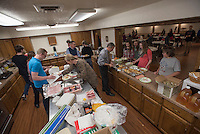 NWA Democrat-Gazette/J.T. WAMPLER Volunteers prepare bacon and pancakes Sunday Feb. 14, 2016 at the First Presbyterian Church in Springdale. The church youth hosted a pancake breakfast to support the Springdale High School snack pack program.