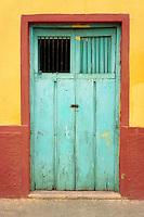 Old wooden door of a house in Santa Elena, Yucatan, Mexico.