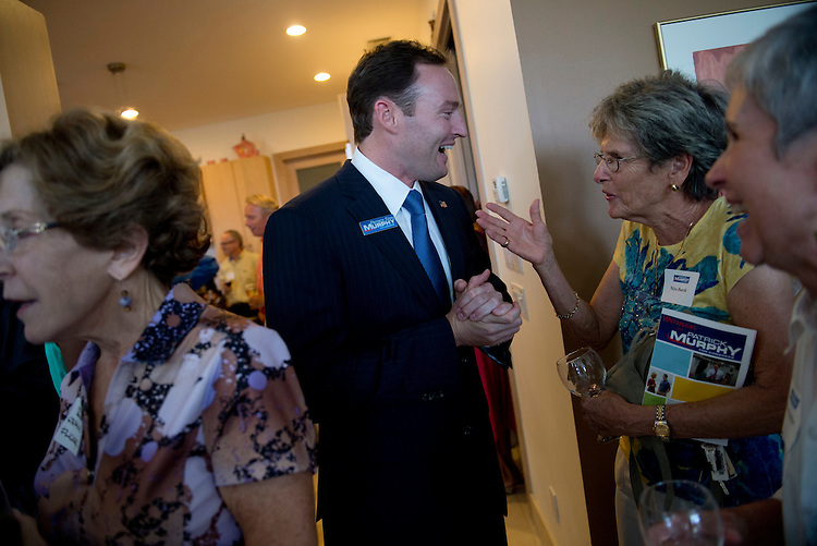 """UNITED STATES - AUGUST 23:  Patrick Murphy, democratic candidate in Florida's 18th District, talks with Nina Barcik at an event in Sewalls Point, Fla., entitled """"Women for Patrick Murphy.""""  Murphy is running against Rep. Allen West, R-Fla.  (Photo By Tom Williams/CQ Roll Call)"""