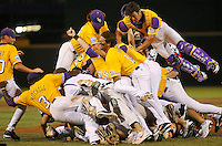 June 24, 2009; Omaha, NE, USA; LSU Tigers dog pile on pitcher Louis Coleman after the last strikeout to defeat the Texas Longhorns 11-4 in game 3 of the 2009 College World Series championships at Rosenblatt Stadium. Mandatory Credit: Crystal LoGiudice-US PRESSWIRE
