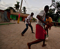 Teens play a street soccer game shortly before the lightless night settles over Jacmel in southern Haiti. The 7.0 earthquake that devastated parts of Haiti on January 12 killed hundreds of thousands of people. January's earthquake killed hundreds of thousands of people and caused significant and lasting structural and economic damage in the Caribbean nation.