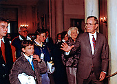 United States President George H.W. Bush conducts a visitors tour in the Grand Foyer of the White House in Washington, D.C. during his first full day as President on January 21, 1989.  First lady Barbara Bush accompanies.<br /> Credit: Dennis Brack / Pool via CNP
