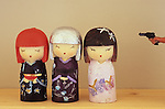Three Japanese dolls and gun