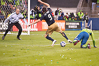 Goalkeeper Kasey Keller (l) keeps his eye on the ball as Sebastien Le Toux (c) tries to get off a kick while Jhon Kennedy Hurtado (r) defends as the Seattle Sounders defeated the Philadelphia Union, 2-0, in an MLS match on Thursday, March 25, 2010 at Qwest Field in Seattle, WA. It was the Sounders home opener and the first regular season game for the expansion Philadelphia Union.