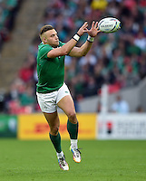 Ian Madigan of Ireland receives the ball. Rugby World Cup Pool D match between Ireland and Romania on September 27, 2015 at Wembley Stadium in London, England. Photo by: Patrick Khachfe / Onside Images