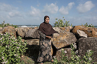 """Indonesia – Sumatra – Banda Aceh – Nurlaila, 48-years old lost her husband and one son during the tsunami. """"I still remember that day very well. I will never be able to forget it. I try to cope by being religious and telling to myself that it all came from God"""". From that terrible experience that completely destroyed her house and life, Nurlaila was able to salvage only few thousands rupiahs and a praying book. Today, she lives in her new house in Lampulo, her home village, surviving thanks to a pension and by selling peanuts. """"It's hard"""" she admits. """"I am alone and have to provide for my 23-year-old son, who is attending college. But my family got strength by the fact that a lot of people here had the same experience. We feel we are not alone""""."""