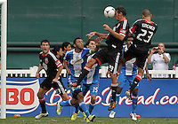 WASHINGTON, D.C. - AUGUST 19, 2012:  Emilliano Dudar (19) of DC United heads the ball over Carlos Valdés (2) of the Philadelphia Union during an MLS match at RFK Stadium, in Washington DC, on August 19. The game ended in a 1-1 tie.