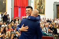 Roma 21 Maggio 2015<br /> Celebration Day, l&rsquo;inaugurazione del registro delle unioni civili in Campidoglio. Sono 17 le coppie che si sono presentate per l&rsquo;iscrizione: coppie omosessuali ed eterosessuali che dopo anni di convivenza  festeggiano con lo scambio degli anelli, la cerimonia si &egrave; svolta nella sala della Protomoteca di Palazzo Senatorio.<br /> Rome May 21, 2015<br /> Celebration Day, the opening of the register of civil unions in the Capitol. Are 17 couples that have occurred for registration: homosexual and heterosexual couples who, after years of living together celebrate with the exchange of rings, the ceremony was held in the hall of Protomoteca Palazzo Senatorio.Same-sex couple Leonardo Pace and Fabio Motti during the ceremony for  registered their civil union at Rome's city hall on May 21, 2015 in Rome.
