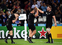 Codie Taylor of New Zealand is congratulated on his try. Rugby World Cup Pool C match between New Zealand and Namibia on September 24, 2015 at The Stadium, Queen Elizabeth Olympic Park in London, England. Photo by: Patrick Khachfe / Onside Images
