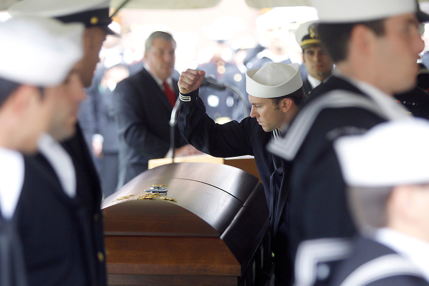TOMS RIVER, N.J. --A Navy SEAL pounds his Special Warfare insignia, also known as a SEAL Trident, into the lid of the casket containing the remains of his fallen comrade during a funeral at Ocean County Memorial Park. Dennis C. Miranda, 24, a Navy Seal from Toms River was killed in a helicopter crash in southern Afghanistan last week.  (9/30/2010)  photo by Andrew Mills/The Star-Ledger.. Sent DIRECT TO SELECTS Thursday, September 30, 2010 15:02:12 4896 3264